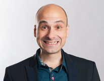 Funny bald dude expressive portrait. Studio shot Royalty Free Stock Images