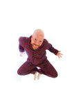 Funny bald man. A funny bald man wearing flannel pajamas jumping in the air Royalty Free Stock Photos