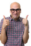 Funny bald man gestures thumbs up Stock Photo