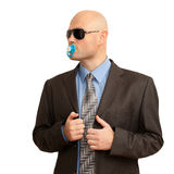 Funny bald man in suit with soother. Isolated on white Stock Photo