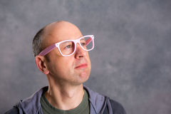 Funny baldheaded man with pink glasses Stock Images
