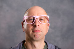 Funny baldheaded man with pink glasses Royalty Free Stock Photo