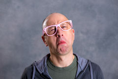 Funny baldheaded man with pink glasses Royalty Free Stock Images