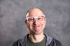 Funny baldheaded man with pink glasses Royalty Free Stock Photos