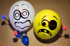 Funny balloon faces are scared Stock Image