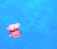 Funny bath. Little toy in a bath carries a flower royalty free stock image