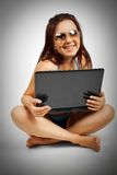 Funny beach girl with laptop Stock Images