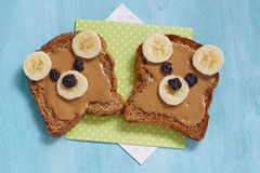 Funny bear face sandwich with peanut butter, banana and raisins Stock Image