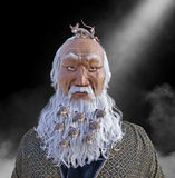 Funny Beard Crowded with Mice. An old Asian man with a long white beard has mice living in his beard. the male has a big grin on his face for the mouse on top of Royalty Free Stock Photography