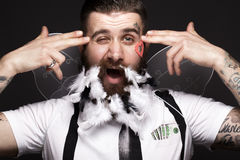 Funny bearded man with feathers and wings in the image of Cupid Valentine`s Day. Stock Image
