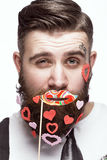 Funny bearded man with hearts Valentine`s Day. stock image