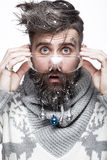 Funny bearded man in a New Year`s image with snow and decorations on his beard. Feast of Christmas. Photos shot in the studio Royalty Free Stock Photos
