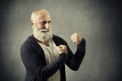 Funny bearded man standing in boxing pose Stock Photography