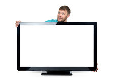 Funny bearded man wrapped his arms around the wide TV set on white background. File contains a path to isolation. Funny bearded man wrapped his arms around the Royalty Free Stock Photography