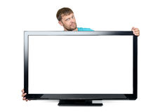 Funny bearded man wrapped his arms around the wide TV set on white background. File contains a path to isolation. Royalty Free Stock Photos