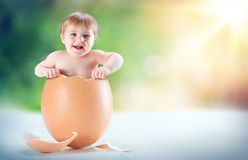 Funny And Beautiful Baby Appear In A Egg. Birth concept royalty free stock photos