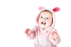 Funny beautiful baby with blue eyes wearing a bunny costume playing and laughing. Isolated on white Royalty Free Stock Photo