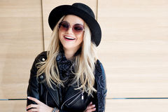 Funny and beautiful blonde in sun glasses and a hat. Trendy girl portrait outdoor. Happy smile Royalty Free Stock Images