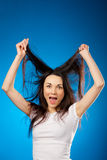 Funny beautiful brunette girl holding her long hair up Royalty Free Stock Image