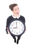 Funny beautiful business woman showing clock isolated on white Stock Photography