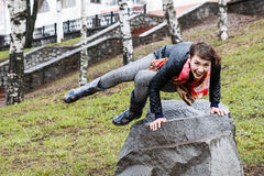 Funny beautiful girl do physical exercises in the Park Stock Photo