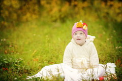 Funny beautiful girl with Down syndrome in the autumn park. Funny beautiful girl with Down syndrome in  the autumn park Royalty Free Stock Photo