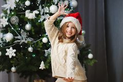 Little beautiful girl with red santa hat royalty free stock photography