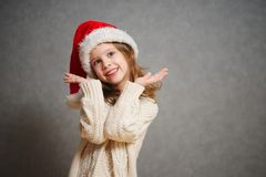 Little beautiful girl with red santa hat stock photo