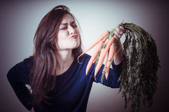 Funny beautiful woman with carrots Royalty Free Stock Photos