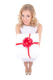 Funny beautiful woman holding gift box isolated on white Royalty Free Stock Images