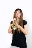 Funny beautiful woman playing trumpet isolated Royalty Free Stock Photos