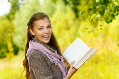 Funny beautiful woman reading book Stock Images