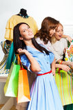 Funny beautiful women shopping together Royalty Free Stock Images