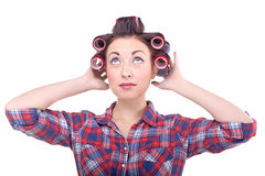 Funny beauty woman with hair rollers looking up. Happy beautiful woman wear hair curlers on head Royalty Free Stock Photos
