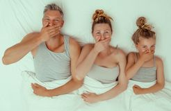 Family bed. Funny bed family tired concept royalty free stock photos