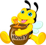 Funny bee cartoon with honey Stock Images