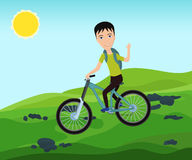 Funny bicyclist traveler with backpack riding a bike on mountain Stock Photography