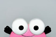 Funny big eyes. Funny smiling face,two big eyes  on the grey background Royalty Free Stock Image