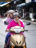 Funny biker with pillion in Hoi An Royalty Free Stock Photo