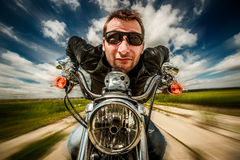 Funny Biker racing on the road Stock Photo