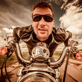 Funny Biker racing on the road Royalty Free Stock Photo
