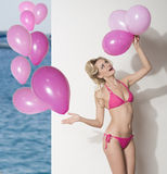Funny bikini girl with balloons Royalty Free Stock Photos