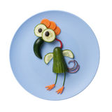 Funny bird made of vegetables. On blue plate Royalty Free Stock Photos