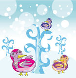 Funny birds in winter garden Stock Photos