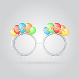 Funny birthday glasses with color ballons Stock Images