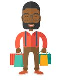 Funny black businessman with shopping bags Royalty Free Stock Photos