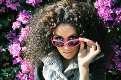 Funny black girl with purple heart glasses Stock Photos