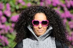 Funny black girl with purple heart glasses Royalty Free Stock Image