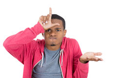 A funny black guy displaying a loser sign Stock Images