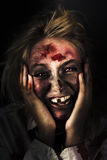 Good Mourning. Face Of A Zombie Apocalypse. Funny Black Horror Image Of A Waking Zombie With Bed Hair Laughing On The Mourning Of The Zombie Apocalypse Royalty Free Stock Images